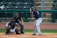 San Antonio Missions second baseman Diego Goris (2) at bat in front of catcher Micah Gibbs and umpire Lee Meyers during a game against the NW Arkansas Naturals on May 31, 2015 at Arvest Ballpark in Springdale, Arkansas.  NW Arkansas defeated San Antonio 3-1.  (Mike Janes/Four Seam Images)