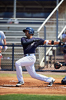 New York Yankees Dermis Garcia (60) follows through on a swing during a minor league Spring Training game against the Detroit Tigers on March 22, 2017 at the Yankees Complex in Tampa, Florida.  (Mike Janes/Four Seam Images)