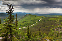 The Elliot highway winds through the boreal forest of interior Alaska.