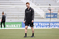 CARY, NC - SEPTEMBER 12: Performance specialist Tom Milroy of the Portland Thorns FC before a game between Portland Thorns FC and North Carolina Courage at Sahlen's Stadium at WakeMed Soccer Park on September 12, 2021 in Cary, North Carolina.