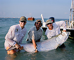 """During the Professional Tarpon Tournament Series in Boca Grande at the Big Pass inlet fishing teams compete for the 1st prize. The biggest tarpon caught on Sunday was 206lbs. but the winning team was TEAM FAMOUS CRAFT. ...Boca Grande Pass, Florida, June 11, 2007- Tropical Storm Barry may have forced the rescheduling of the Miller High Life Professional Tarpon Tournament Series (PTTS) week three and four events in Boca Grande Pass, but both the tarpon and the anglers came back this weekend in full force, making for some exciting fishing during Sunday's double-header tournament..Team Century's Ozzie Fischer, from Ft. Myers, fishing as Team Florida Fishing Weekly/Reel Appeal, scored a victory in the first of the day's tournaments, landing a massive 206-pound tarpon, the second largest fish weighed during a tarpon tournament in the State of Florida. ..Fischer, fishing with teammates Chris Claypool, Dick Rudlaffe and Brian Bogger, didn't have much trouble getting the fish to the scales.  """"We knew it was a big fish, but we were amazed at its cooperation,"""" says Fischer.  """"The fish stayed in about 15-feet of water, allowing us to avoid potential line breaks,"""" says the Team Century angler...""""I was not sure of what to expect from this weekend's fishing, as I had been out of town fishing the FLW Kingfish Series,"""" says Fischer.  """"When I got into the pass, fellow Team Century angler Jeff Totten said that it would take a big fish to win either of today's events,"""" Fischer continued.  """"A 187-pounder had already hit the scales, but when we successfully got the fish to the boat, we knew we had a chance at winning,"""" he said...With the victory, Fischer's team wins a Century 2102 Inshore powered by a reliable Yamaha F150 four-stroke outboard engine, and a Continental aluminum trailer - a retail value exceeding $35,000.  With their victory, and two successful releases in the second of the day's tournaments, Team Florida Fishing Weekly/Reel Appeal"""
