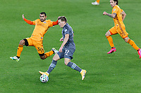 ST PAUL, MN - OCTOBER 18: Robin Lod #17 of Minnesota United FC keeps the ball away from Victor Cabrera #36 of Houston Dynamo during a game between Houston Dynamo and Minnesota United FC at Allianz Field on October 18, 2020 in St Paul, Minnesota.