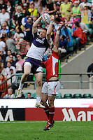 Scott Riddell of Scotland catches the ball ahead of Rhys Shellard of Wales during the iRB Marriott London Sevens at Twickenham on Sunday 13th May 2012 (Photo by Rob Munro)