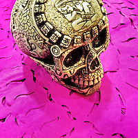 A decorated skull (Calavera) is placed on chiseled paper flags (Papel picado) before the start of the Day of the Dead (Día de Muertos) festivities in Mexico City, Mexico, 27 October 2016.