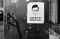 A tribute to Johnny Cash posted on a utility box.  Cash, a giant icon in contemporary American culture, could be seen as an epitome of America. Austin, Texas, USA,  December 2003, © Stephen Blake Farrington