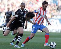 Atletico de Madrid's Adrian Lopez (r) and Granada's Diego Mainz (l) and Filipe Luis (c) during La Liga match.April 14,2013. (ALTERPHOTOS/Acero)