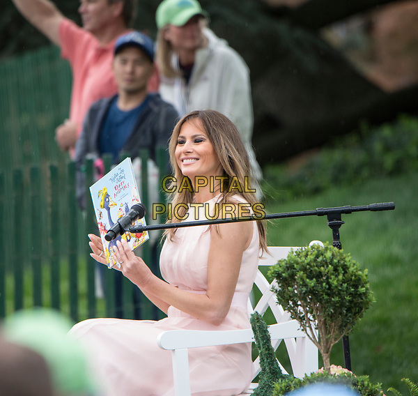 Washington DC, April 17, 2017, USA:First Lady Melania Trump reads to visitors to the South Lawn of the White House for the 139th Annual Easter Egg roll and event in Washington DC. <br /> CAP/MPI/LYN<br /> ©LYN/MPI/Capital Pictures
