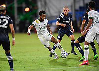 LAKE BUENA VISTA, FL - AUGUST 01: Jeremy Ebobisse #17 of the Portland Timbers dribbles the ball under pressure as Alexander Ring #8 of New York City FC looks on during a game between Portland Timbers and New York City FC at ESPN Wide World of Sports on August 01, 2020 in Lake Buena Vista, Florida.