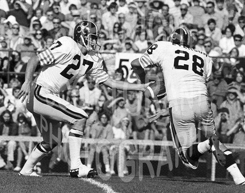 Don Moorhead BC Lions quarterback hands the ball to Jim Evenson 1971. Copyright photograph Scott Grant