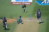 NZ's Daryl Mitchell makes his ground during the third One Day International cricket match between the New Zealand Black Caps and Bangladesh at the Basin reserve in Wellington, New Zealand on Friday, 26 March 2021. Photo: Dave Lintott / lintottphoto.co.nz