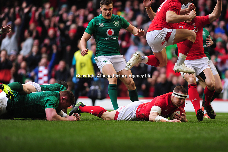 Pictured: Hadleigh Parkes of Wales scores his sides first try during the Guinness six nations match between Wales and Ireland at the Principality Stadium, Cardiff, Wales, UK.<br /> Saturday 16 March 2019