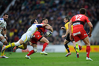 Morgan Parra of ASM Clermont Auvergne tackles Sébastien Tillous-Borde of RC Toulon as he attempts to offload to Juan Martin Hernandez of RC Toulon