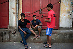 Boys loiter in their area during a 21 days toal lock down of the country for Corona Virus Pandemic. Kolkata, West Bengal, India. Arindam Mukherjee