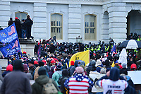 Washington, DC - January 6, 2021: Police move protesters from the entrance of the U.S. Capitol as thousands of people in support of President Donald Trump surround the U.S. Capitol building January 6, 2021 as Congress was in session to accept the electors of the November 3 presidential election.  (Photo by Don Baxter/Media Images International)