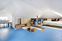 BNPS.co.uk (01202 558833)<br /> Pic: LillicrapChilcott/BNPS<br /> <br /> Pictured: The upstairs bedroom.<br /> <br /> Homebuyers can get the best of coast and country with this spectacular house on the market for offers in excess of £1.5m.<br /> <br /> Westfield sits in an incredible position with views over its own land and the sea at Trevaunance Cove in Cornwall.<br /> <br /> The four-bedroom family home is on the edge of the sought-after village of St Agnes, popular with locals, second home owners and holidaymakers.<br /> <br /> The hub of the home is the open-plan kitchen/family room with a folding door that opens up to the sea-facing terrace.