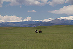 Couple riding horses in Boulder Valley, Colorado, Private guided tours to Indian Peaks. Private photo tours of Boulder. .  John leads private photo tours in Boulder and throughout Colorado. Year-round.