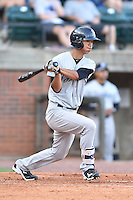 Pulaski Yankees second baseman Gosuke Katoh (28) swings at a pitch during a game against the Greeneville Astros on July 11, 2015 in Greeneville, Tennessee. The Yankees defeated the Astros 9-3. (Tony Farlow/Four Seam Images)
