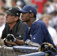 Tacoma Rainers outfielder Adam Jones talks with coach Alan Cockrell during practice before the Triple-A All-Star Game at Fifth Third Field on July 12, 2006 in Toledo, Ohio.  (Mike Janes/Four Seam Images)