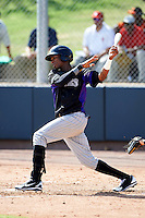 Colorado Rockies minor league outfielder Julian Yan #9 during an instructional league game against the San Francisco Giants at the Salt River Flats Complex on October 4, 2012 in Scottsdale, Arizona.  (Mike Janes/Four Seam Images)