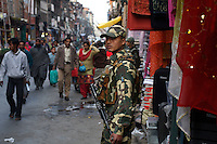 Paramilitary soldier of CRP in busy shopping area of Srinagar, Kashmir,India. © Fredrik Naumann/Felix Features