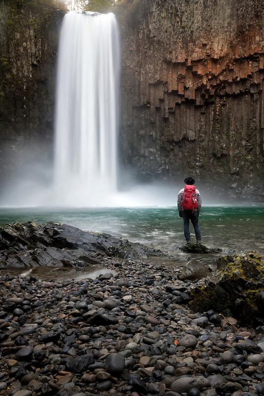 Hiker at base of Abiqua Falls. Oregon
