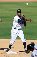 Phoenix Desert Dogs infielder Tim Beckham #33, of the Tampa Bay Rays organization, during an Arizona Fall League game against the Surprise Saguaros at Phoenix Municipal Stadium on October 18, 2012 in Phoenix, Arizona.  The game was called after eleven innings with a 2-2 tie.  (Mike Janes/Four Seam Images)