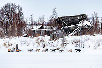 Jeff King runs past a derelict building as he approaches the ghost town of Iditarod on Thursday, March 8th during the 2018 Iditarod Sled Dog Race -- Alaska<br /> <br /> Photo by Jeff Schultz/SchultzPhoto.com  (C) 2018  ALL RIGHTS RESERVED