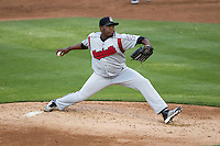 Nashville Sounds pitcher Frankie De La Cruz (34) delivers a pitch to the plate in the Pacific Coast League baseball game against the Round Rock Express on May 4, 2013 at the Dell Diamond in Round Rock, Texas. Round Rock defeated Nashville -6. (Andrew Woolley/Four Seam Images).