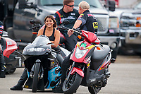Aug 31, 2019; Clermont, IN, USA; NHRA pro stock motorcycle rider Jianna Salinas with crew members during qualifying for the US Nationals at Lucas Oil Raceway. Mandatory Credit: Mark J. Rebilas-USA TODAY Sports