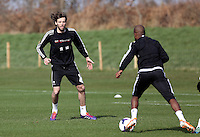 Pictured: Michu (L). Saturday 08 March 2014<br />