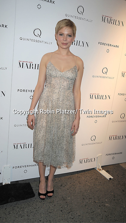 """Michelle Williams in Erdem dress attends The New York Premiere of """"My Week With Marilyn"""" on November 13, 2011 at the Paris Theatre in New York City. The movie stars Michelle Williams, Kenneth Branagh, Dominic Cooper and Zoe Wanamaker."""