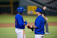 AZL Cubs coach Ben Carhart talks to Nelson Velazquez (20) during a game against the AZL Angels on August 31, 2017 at Sloan Park in Mesa, Arizona. AZL Cubs defeated the AZL Angels 9-2. (Zachary Lucy/Four Seam Images)