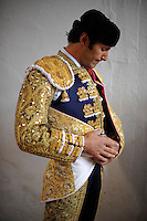 Spanish matador David Mora gets ready before the fourth corrida of the San Fermin Festival, on July 10, 2012, in the Northern Spanish city of Pamplona. (c) Pedro ARMESTRE
