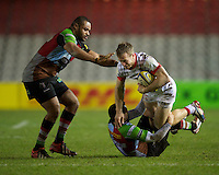 James Short of Saracens Storm is tackled by Karl Dickson of Harlequins 'A' as team mate Darryl Marfo looks on during the Aviva Premiership A League Final between Harlequins A and Saracens Storm at the Twickenham Stoop on Monday 17th December 2012 (Photo by Rob Munro)
