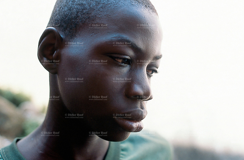 Sierra Leone. Freetown.Homeless boy who uses to be a soldier of the RUF (Revolutionary United Front) rebels during the war. He has no job and live with a group of ex-soldiers mostly children in the streets near the harbour. © 2002 Didier Ruef