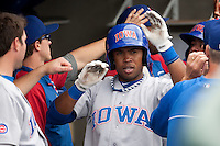 Iowa Cubs third baseman Luis Valbuena #27 in the dugout after hitting a grand slam during the Pacific Coast League baseball game against the Round Rock Express on April 15, 2012 at the Dell Diamond in Round Rock, Texas. The Express beat the Cubs 11-10 in 13 innings. (Andrew Woolley / Four Seam Images).
