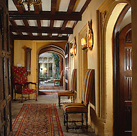 View along a stone-flagged corridor which leads to a courtyard garden