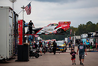 Sep 27, 2020; Gainesville, Florida, USA; The car of NHRA funny car driver Tommy Johnson Jr is loaded into the hauler in the pits during the Gatornationals at Gainesville Raceway. Mandatory Credit: Mark J. Rebilas-USA TODAY Sports