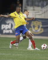 Jermaine Jones #15 of the USA MNT tangles with Aquivaldo Mosquera #2 of Colombia during an international friendly match at PPL Park, on October 12 2010 in Chester, PA. The game ended in a 0-0 tie.