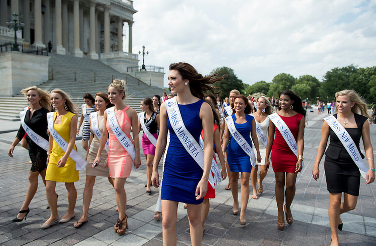 UNITED STATES - SEPTEMBER 2: Miss America pageant contestants walk across the East Plaza to the Capitol Visitor Center for their tour of the U.S. Capitol on September 2, 2014. (Photo By Bill Clark/CQ Roll Call)