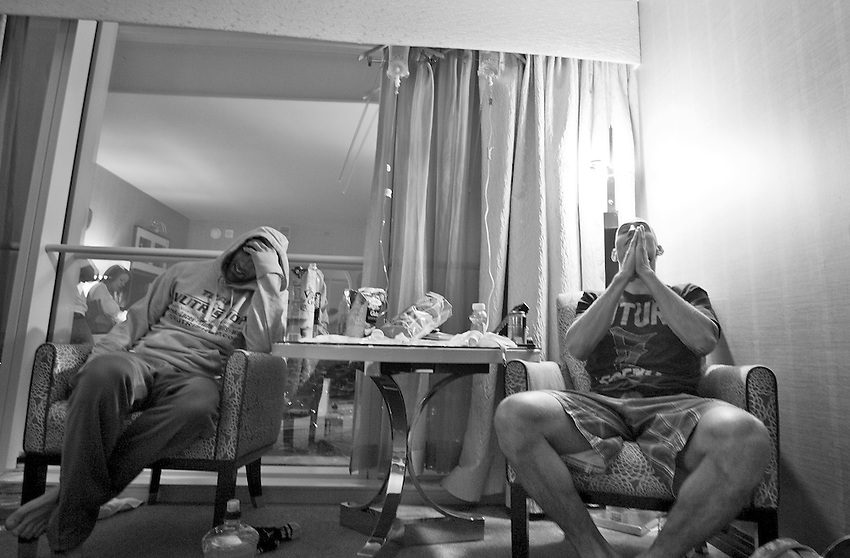"""George Sullivan (left) holds his head as Derrick """"DK"""" Kennington says a prayer as they rehydrate themselves with fluids from I.V. bags after weighing in at the Borgata. Both men will be fighting in less than 24 hours."""