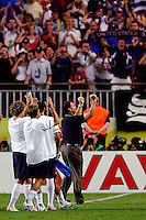 U.S. coach Bruce Arena (blue) and players Chris Albright, Eddie Lewis and Clint Dempsey acknowledge the American fan support. The USA and Italy played to a 1-1 tie in their FIFA World Cup Group E match at Fritz-Walter-Stadion, Kaiserslautern, Germany, June 17, 2006.