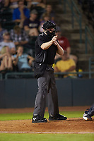 Home plate umpire Mitch Leikam makes a strike call during the South Atlantic League game between the Charleston RiverDogs and the Hickory Crawdads at L.P. Frans Stadium on August 10, 2019 in Hickory, North Carolina. The RiverDogs defeated the Crawdads 10-9. (Brian Westerholt/Four Seam Images)