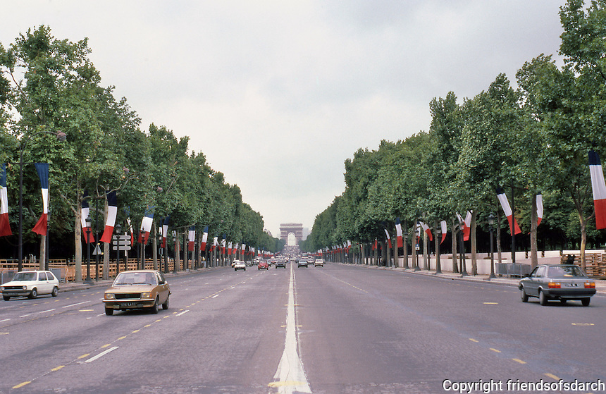 Paris: Place de la Concorde--looking up the Champs to the Arc de Triomphe. The tri-colors are up for July 14--Bastille Day. Photo '87.