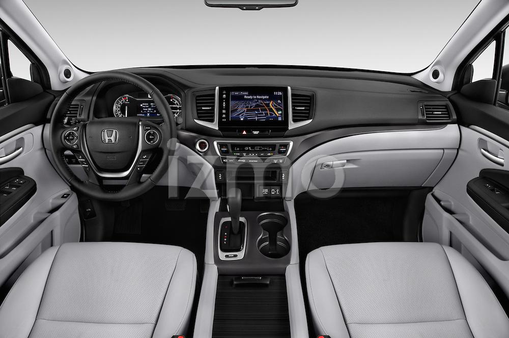 Stock photo of straight dashboard view of 2018 Honda Ridgeline RTL-T 4 Door Pick-up Dashboard