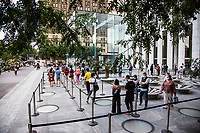 NEW YORK, NY - AUGUST 19: People line up outside the Apple store on Fifth Avenue on August 19 2020 in New York City. Tech giant Apple has become the first American company to boast a $2 trillion market value, after just two years becoming the first to reach $1 trillion (Photo by Pablo Monsalve / VIEWpress via Getty Images)