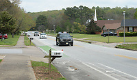 Traffic travels west Thursday, April 29, 2021, on Rolling Hills Drive past Loxley Avenue in Fayetteville. The city has a planned $4.4 million project using money voters approved in April 2019 to redesign Rolling Hills Drive with two mini-roundabouts, new pedestrian crossings and narrower driving lanes, with a turning lane in the middle. Visit nwaonline.com/210430Daily/ for today's photo gallery. <br /> (NWA Democrat-Gazette/Andy Shupe)