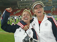26 August 2004: April Heinrichs celebrate with Tracey Leone to USA fans after USA defeated Brazil for the gold medal at Karaiskakis Stadium in Athens, Greece.   USA defeated Brazil, 2-1 in overtime.   Credit: Michael Pimentel / ISI.