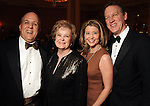 From left: Rich Levy, Lynn Guggolz, Carolyn Henneman and Matt Henneman at the Imprint Poets & Writers Ball at the Houston Country Club  Feb 18,2012. (Dave Rossman/For the Chronicle)