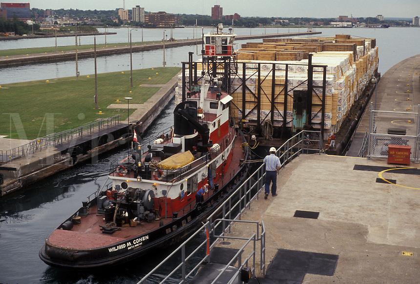 AJ2813, Soo Locks, lock, Upper Peninsula, U.P., Michigan, Lake Superior, Sault Ste. Marie, A tugboat pushes a barge out of the lock at Soo Locks in Sault Sainte Marie in the state of Michigan.